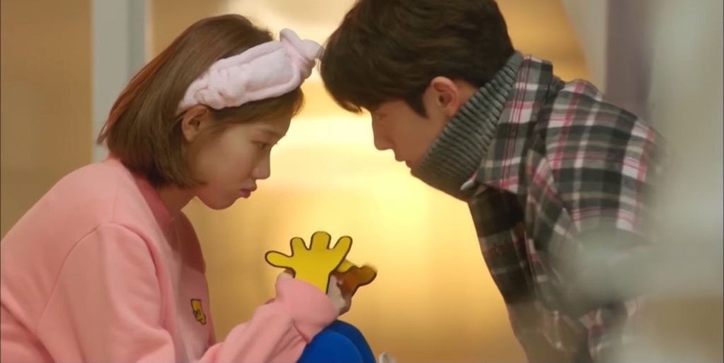 KDrama Weightlifting Fairy Kim Bok Joo wearing the pink hoodie with yellow arms
