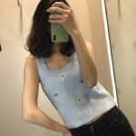Baby Blue Sleeveless Knit Top With Floral Embroidery | IU